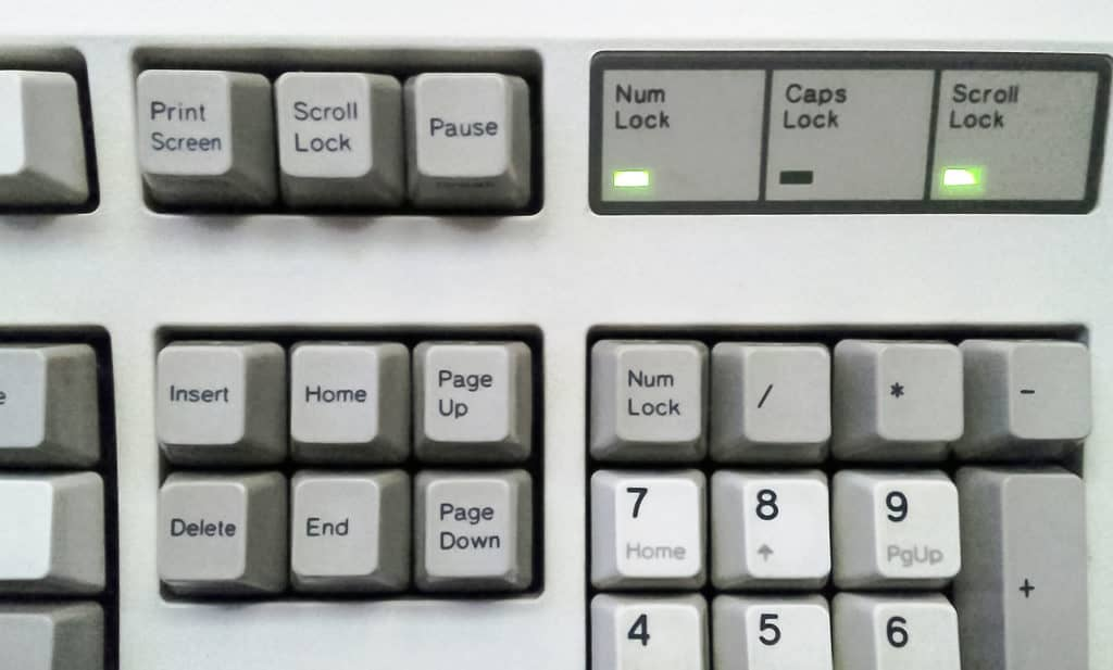 Typing hands, keyboard typing symbols instead of letters.