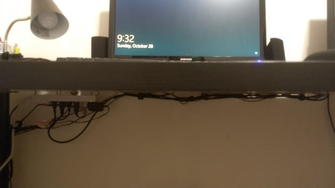 Hide Keyboard and Mouse Cables with tape cables under desk